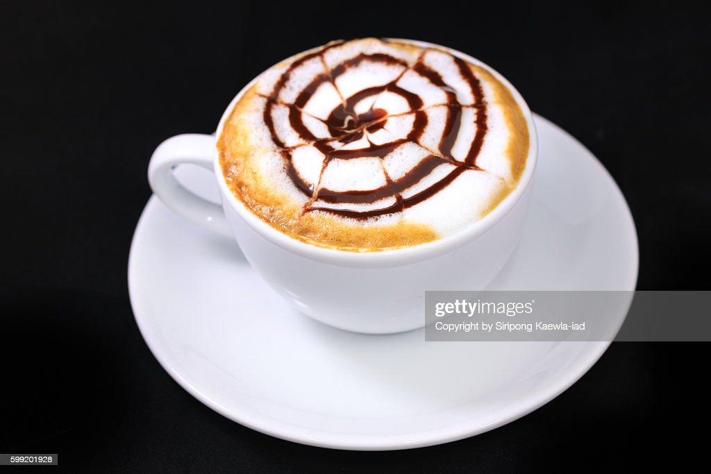 High angle view of a cup of coffee latte with cream and chocolate sauce. : Stock Photo