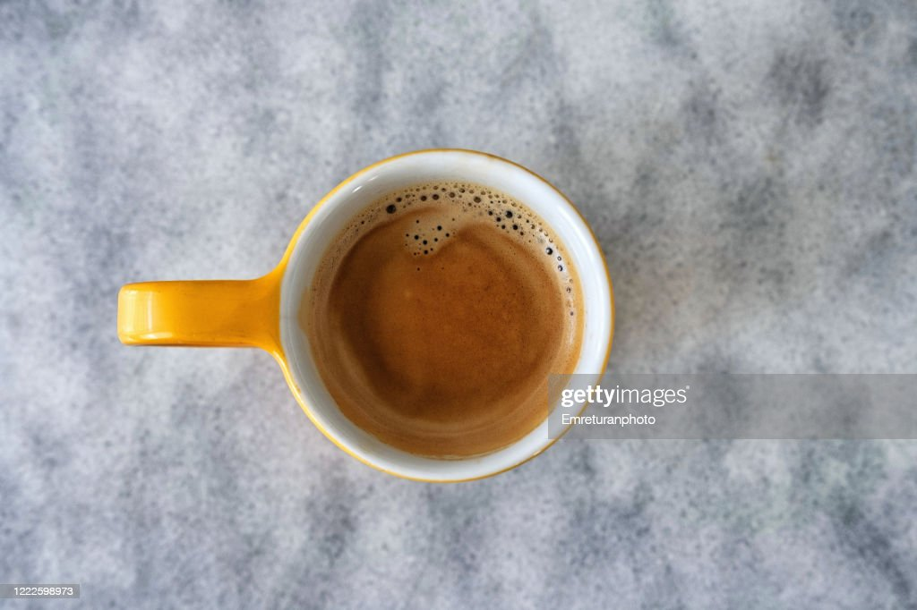 High angle view of a cup of expresso on marble surface. : Stock Photo
