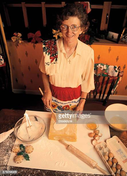 high angle view of a elderly woman baking in the kitchen