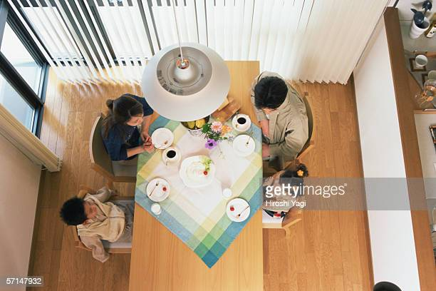 High angle view of a family having breakfast together