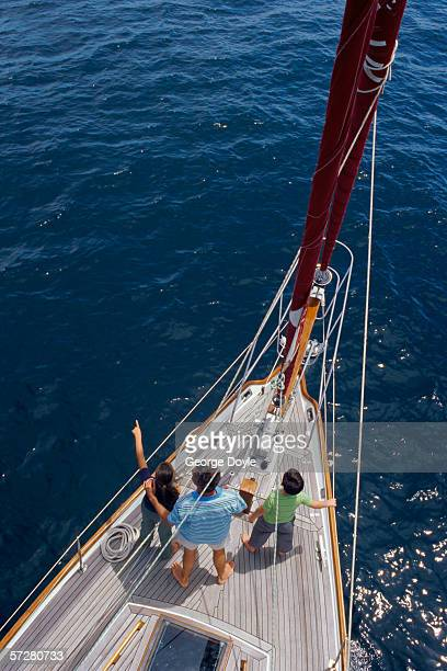 High angle view of a father with his two children on a sailboat
