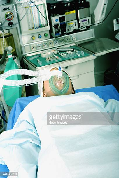 High angle view of a female patient lying on an operating table