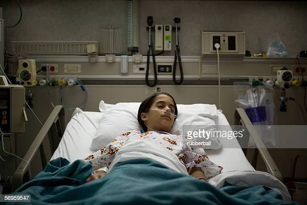 High angle view of a female patient sleeping on a hospital bed