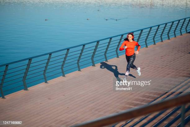 high angle view of a fit young female jogger training outdoors - serbia stock pictures, royalty-free photos & images