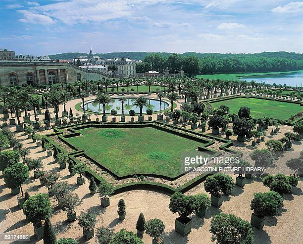 High angle view of a formal garden in front of a palace Palace Gardens Palace of Versailles IleDeFrance France