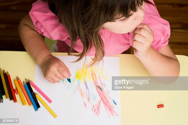 high angle view of a girl drawing on a sheet of paper and thinking - colouring stock pictures, royalty-free photos & images