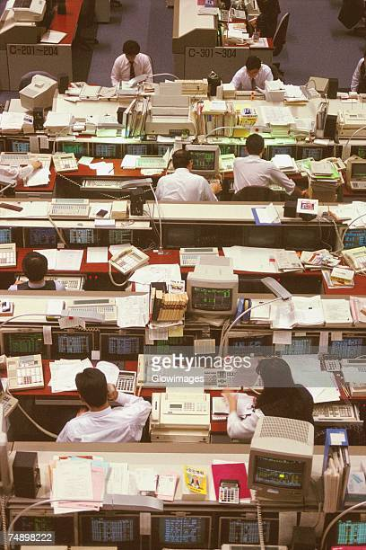 High angle view of a group of people working in a financial company, Tokyo Prefecture, Japan
