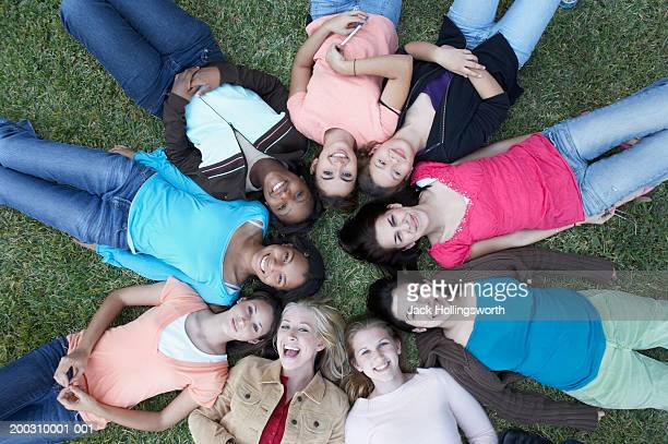 high angle view of a group of teenagers lying on a lawn - only teenage girls stock pictures, royalty-free photos & images