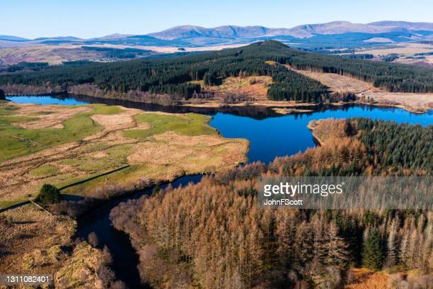 high angle view of a lake and river in the morning - johnfscott stock pictures, royalty-free photos & images