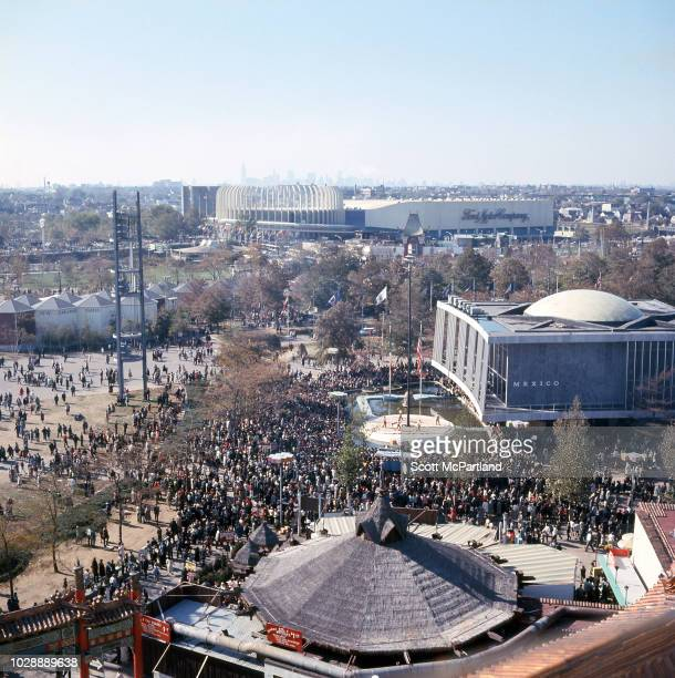 High angle view of a large crowd gathered in front of the Philippines Pavilion during the World's Fair in Flushing Meadows Park in Queens New York...