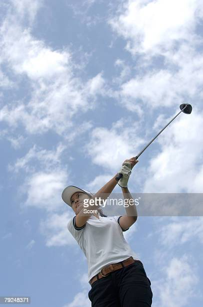 high angle view of a man playing a golf stroke - golfschwung stock-fotos und bilder