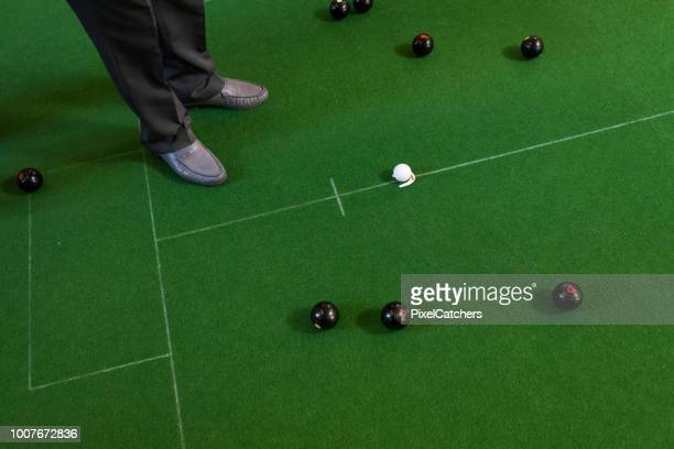 high angle view of a man's feet and bowling balls - bowl stock pictures, royalty-free photos & images