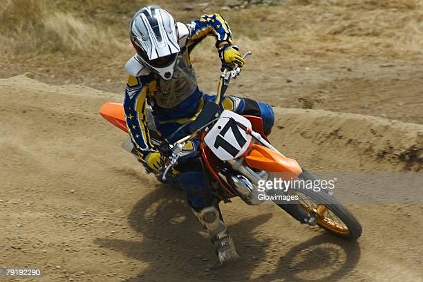 High angle view of a motocross rider riding a motorcycle