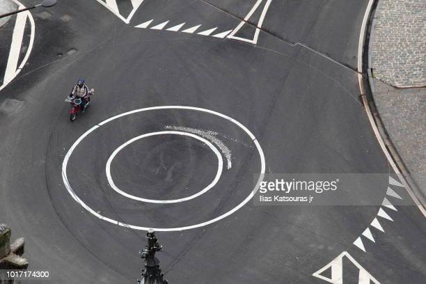 High angle view of a motorcycle crossing roundabout