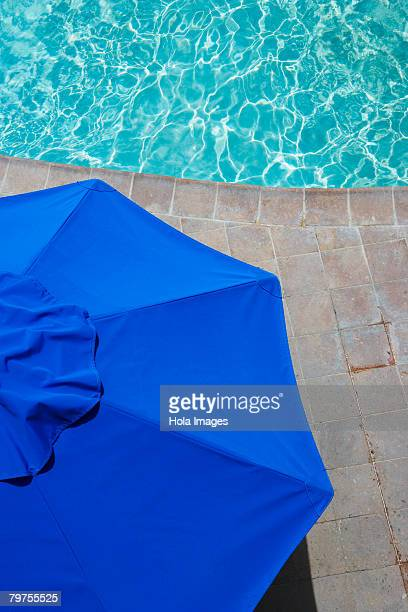 High angle view of a patio umbrella at the poolside