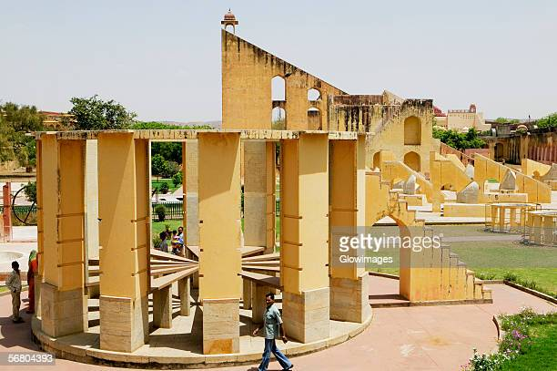 high angle view of a person walking in an observatory, jantar mantar, jaipur, rajasthan, india - jantar mantar stock pictures, royalty-free photos & images