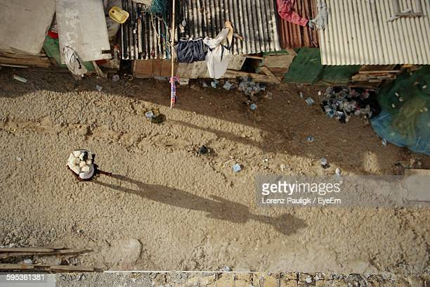 High Angle View Of A Person Walking With Shadow On Ground
