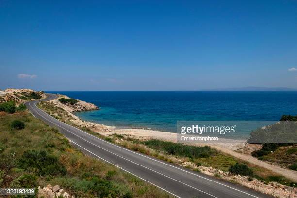 high angle view of a road along the shoreline , aegean turkey. - emreturanphoto stock pictures, royalty-free photos & images