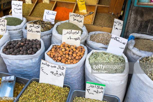 high angle view of a selection of colourful spices in bags. - arabic script stock pictures, royalty-free photos & images