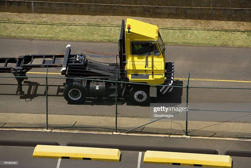 High angle view of a semi-truck at a commercial dock : Stock Photo