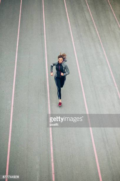 high angle view of a sprinter running on track - sprinting stock pictures, royalty-free photos & images
