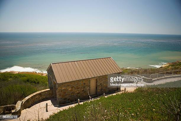 High angle view of a stone cottage on a waterfront, Pacific Ocean, San Diego, California, USA
