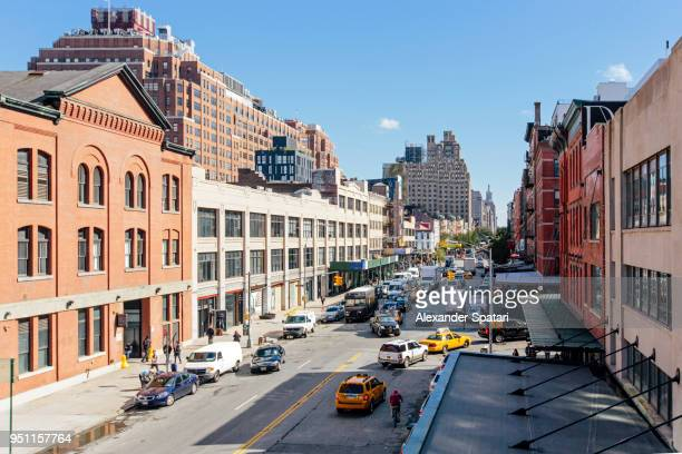 high angle view of a street with cars and traffic in chelsea district, new york city - chelsea new york stock photos and pictures