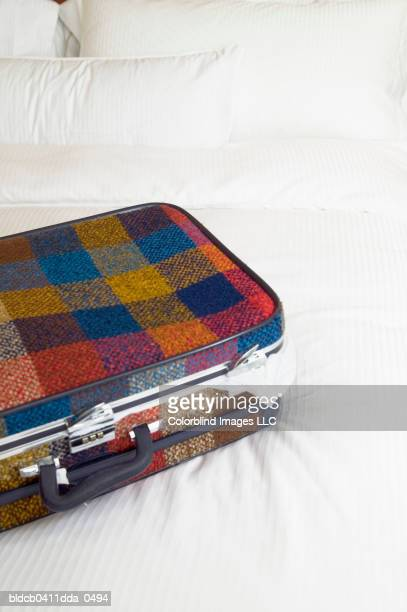 High angle view of a suitcase on a bed