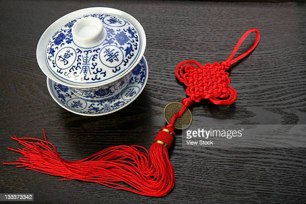 high angle view of a tea cup and a chinese knot - chinese knotting stock pictures, royalty-free photos & images