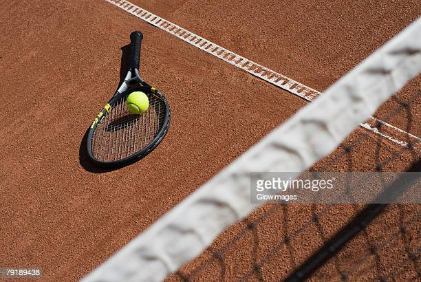High angle view of a tennis ball on a racket in a court