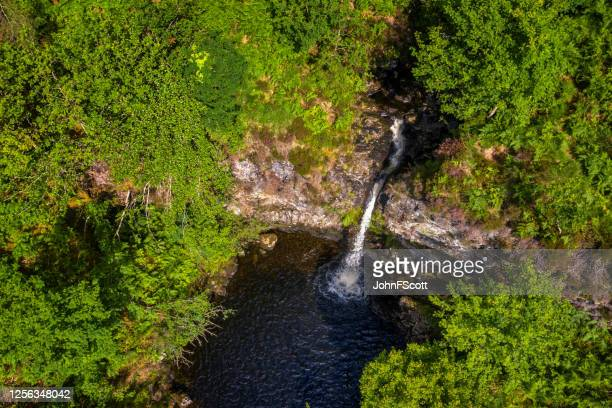 high angle view of a waterfall in an area of woodland in remote rural dumfries and galloway, south west scotland - johnfscott stock pictures, royalty-free photos & images