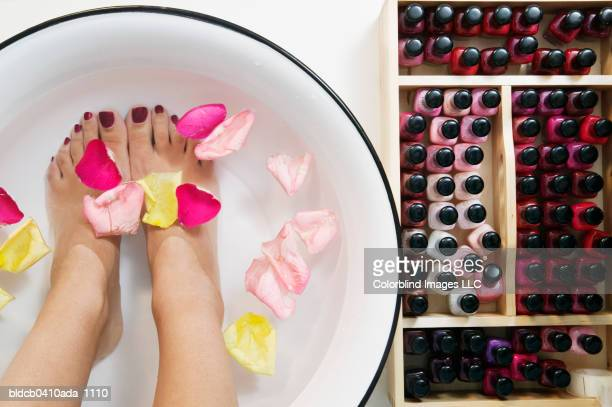 High angle view of a woman's feet in a bowl full of water