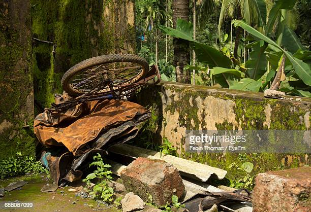 High Angle View Of Abandoned Bicycle On Scrap Metal In Back Yard