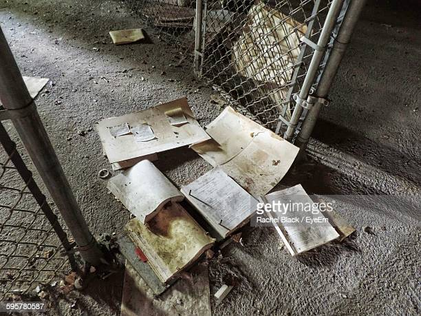 High Angle View Of Abandoned Books By Fence