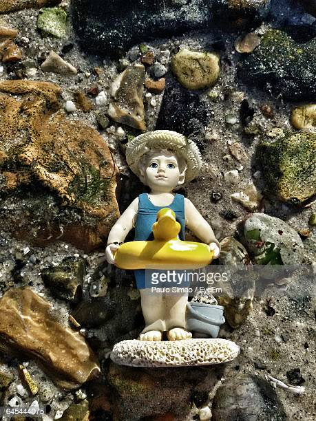 High Angle View Of Abandoned Figurine At Beach
