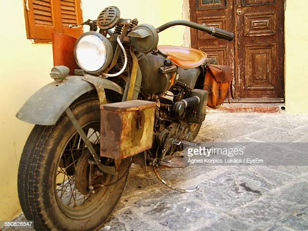 High Angle View Of Abandoned Motorcycle On Street By House