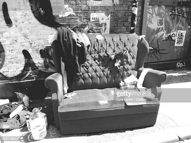 high angle view of abandoned sofa on sidewalk during sunny day - bethnal green stock pictures, royalty-free photos & images