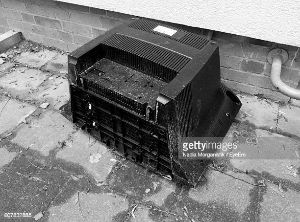 High Angle View Of Abandoned Television Set On Street