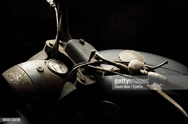 high angle view of abandoned vintage motorcycle against black background - vintage motorcycle stock pictures, royalty-free photos & images