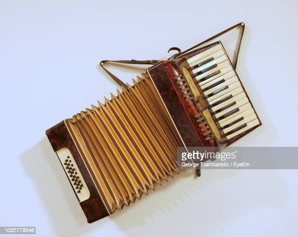 high angle view of accordion on white background - accordion instrument stock pictures, royalty-free photos & images