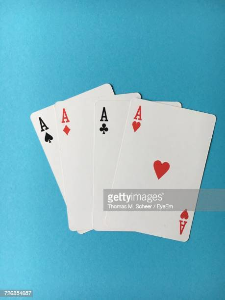 High Angle View Of Aces Cards On Green Table