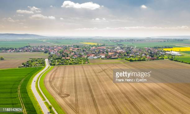 high angle view of agricultural field against sky - wolfsburg lower saxony stock pictures, royalty-free photos & images