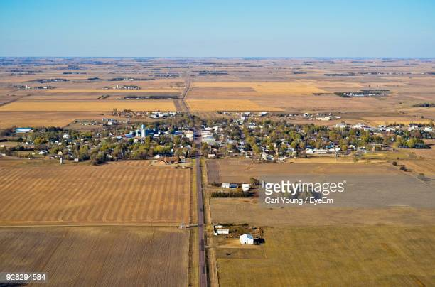 high angle view of agricultural field against sky - town stock pictures, royalty-free photos & images
