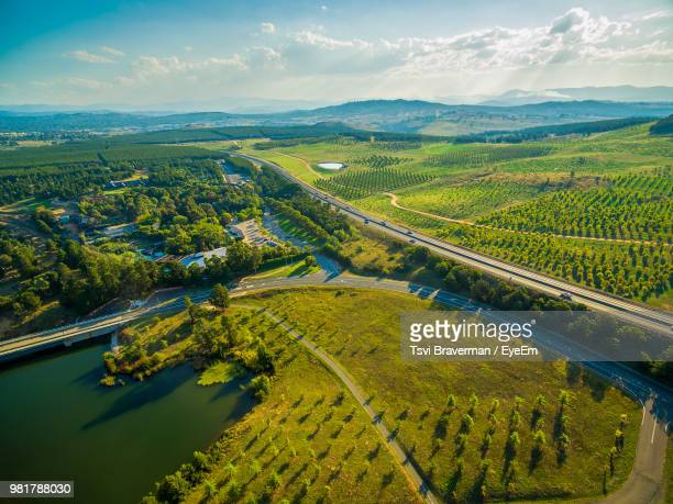 high angle view of agricultural field against sky - australian capital territory stock pictures, royalty-free photos & images