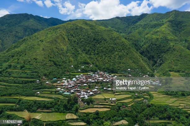 high angle view of agricultural field by buildings - rice terrace stock pictures, royalty-free photos & images