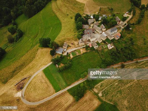 high angle view of agricultural field - villaggio foto e immagini stock
