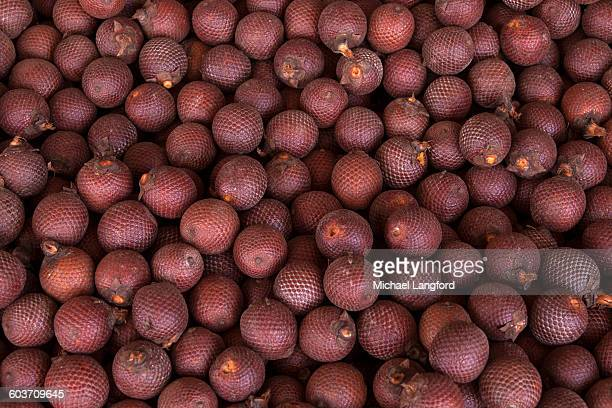 High Angle View of aguaje, buriti or moriche palm fruits (Mauritia flexuosa) for sale at a local market, Puerto Maldonado, Tambopata Province, Madre de Dios Region, Peru.