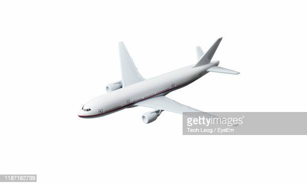 high angle view of airplane against white background - avion photos et images de collection