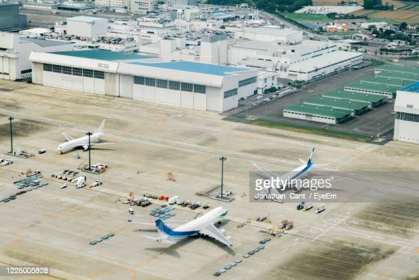 high angle view of airplane on airport runway - narita stock pictures, royalty-free photos & images