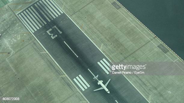High Angle View Of Airplane On Airport Runway